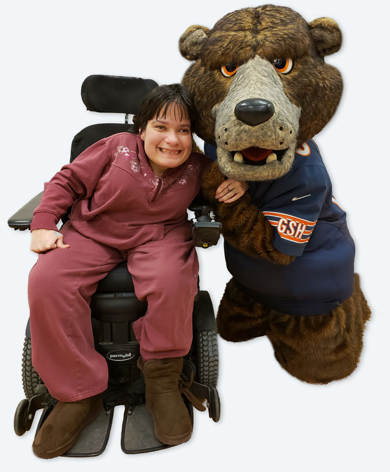 Smiling woman posing with Bears mascot